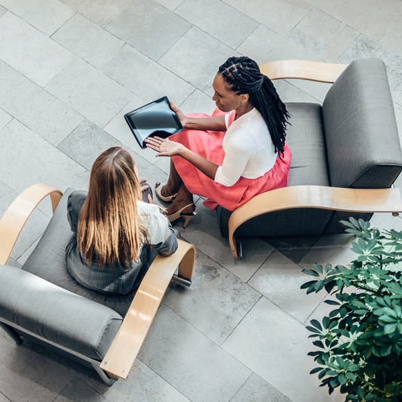 Two female employees in a meeting - Boyd Insurance